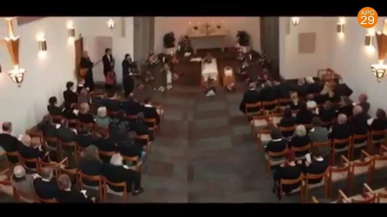 Marie och Joels begravning.