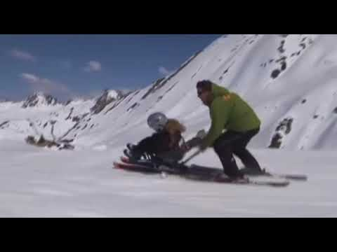 Flying Down The Hill On A Sit Ski