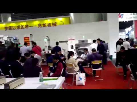 SHENZHEN ZHAOLONG CI printer worked with DINGYU Automatic Butt splice winding system in their booth