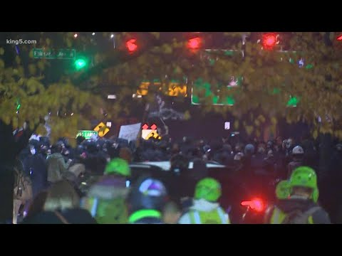 Demonstrators march through downtown Seattle streets on Election Night