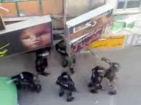 Tehran Police kicking the doors