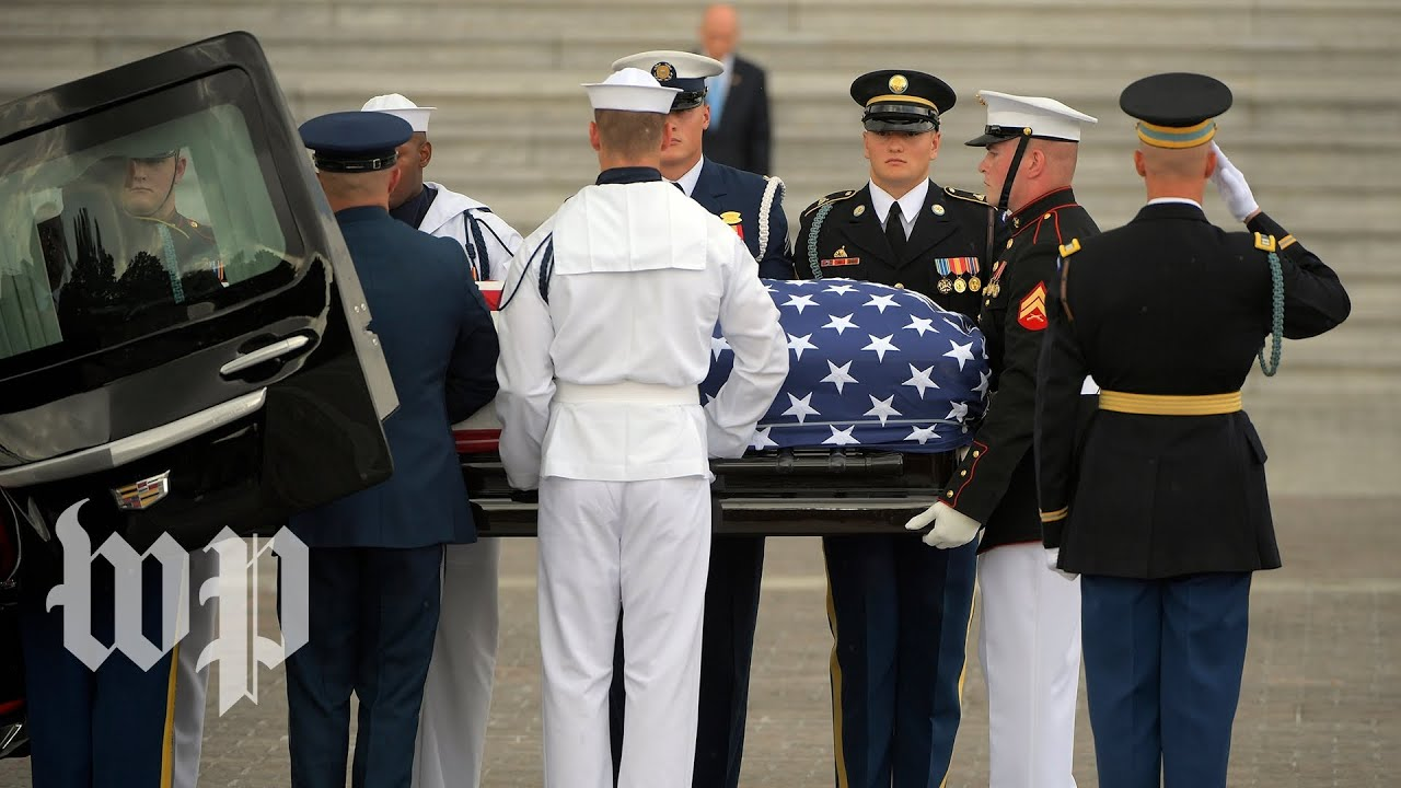 Rain falls as McCain's casket is carried into Capitol