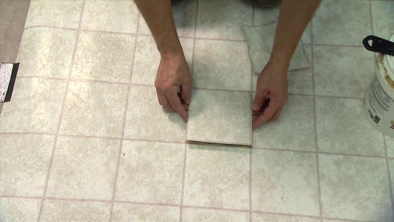 fixing vinyl floor tiles