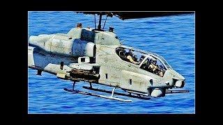 De AMERIKAANSE Militaire AH-1W SUPER COBRA piloten vliegen in Militaire oefening