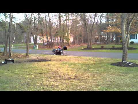 Reggie hits jump with lawn mower(DA)