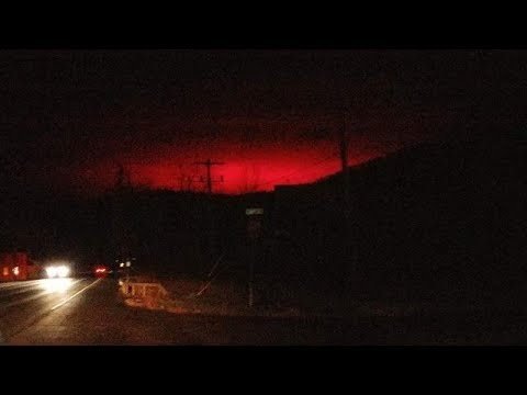 Chilling moment night sky turns RED as 'alien explosions' erupt over New York