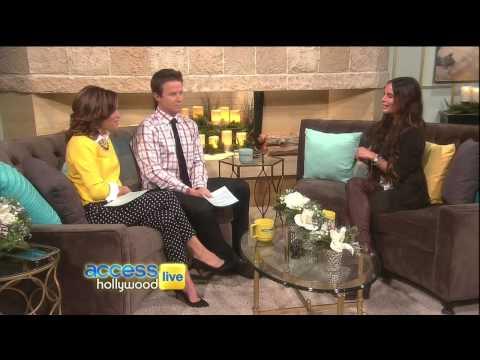 Gabrielle Anwar chats in thigh high boots