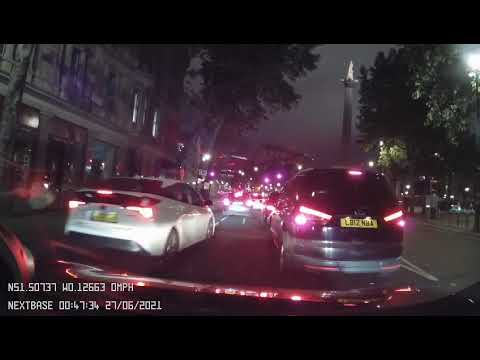 Minicab driving on a cycle lane