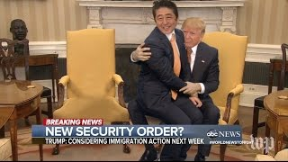Trump Long Handshake with Prime Minister of Japan