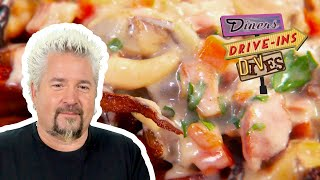 Guy Fieri Dives Into Seafood CHOWDER-Topped French FRIES | Diners, Drive-Ins and Dives