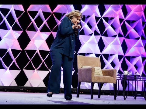 A Women Throw her Shoes to Hilary Clinton