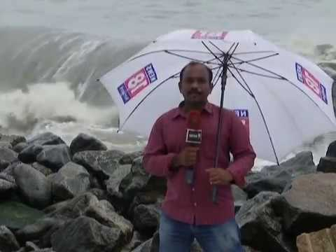 funny live reporter hit by sea wave