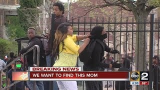Story behind the video: Mom beats son for throwing rocks at police in Baltimore