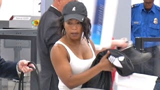 Angela Bassett Shows Of Her Biceps Going Through LAX TSA
