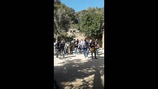 Funny street musicians in Park Güell - Barcelona, spain