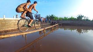 NTN - Thử Thách Đua Xe Đạp Trên Cầu Tre 10 CM (Racing by bike on 10 cm bamboo brigde)