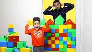 Yusuf pretend play with colored blocks