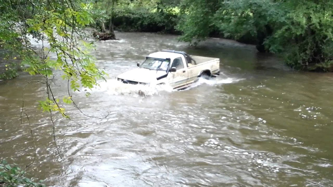 Toyota hilux pickup wading tho swollen river by 4x4steve