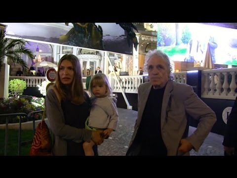 Director Abel Ferrara and wife posing for photographers in Cannes