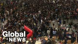 Hong Kong protesters occupy airport for third day