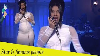 Cardi B revealed a massive baby bump during her first appearance on...