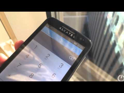 Transparent solar panel in screen charges an Alcatel phone