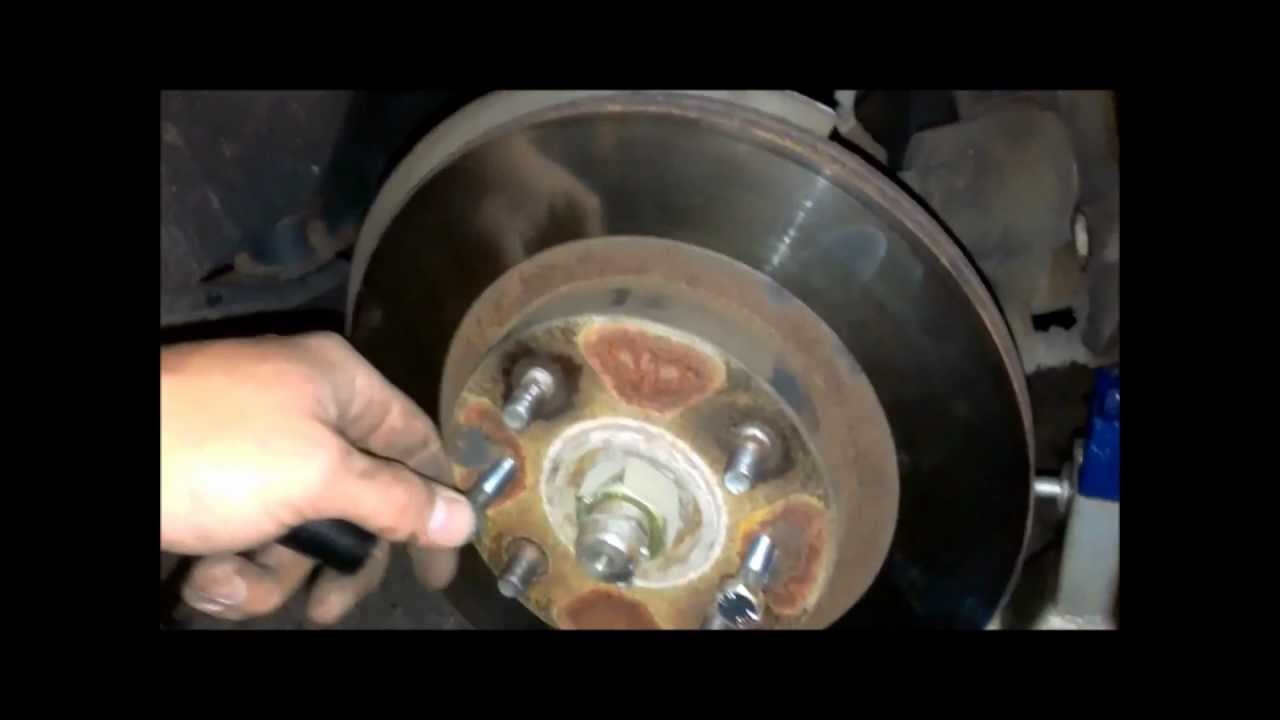 Changing Rotors And Brake Pads On A 2000 Nissan Altima