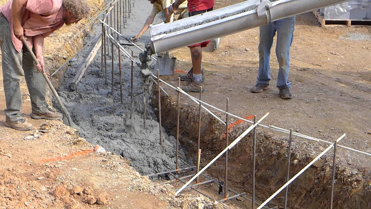 Pouring Footings for Courtyard Retaining Wall - YouTube