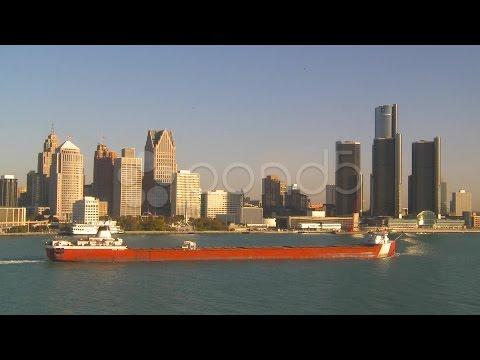 Maritime Transportation - Great Lakes Cargo Ship Through Frame, Detroit Skyline. Stock Footage