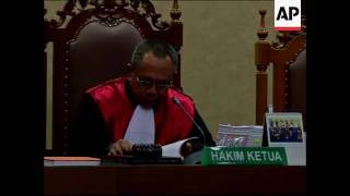 Cyanide murder trial of Indonesian woman | AP Archive