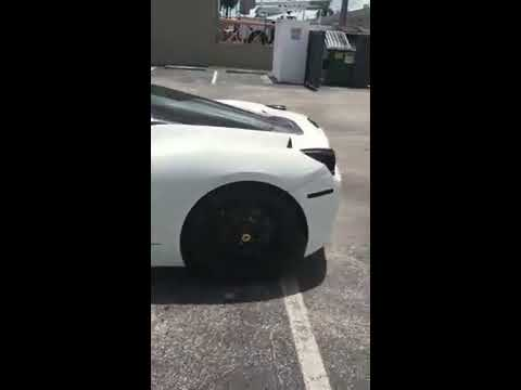 Delivery of a 2015 Porsche Cayman, Ferrari is unloaded