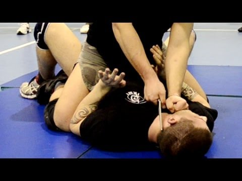 KRAV MAGA TRAINING • Knife to throat Disarm on the ground