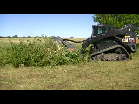 Caterpillar Skid Steer >> CAT 299D XHP w/ Loftness Carbide G3 Cutter - YouTube