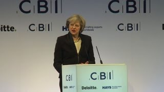 PM May seeks to soothe Brexit fears at business summit
