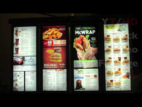 McDonalds Drive Thru w/ Fast Food Menu & Window at Late Night Hours | HD Stock Video Footage