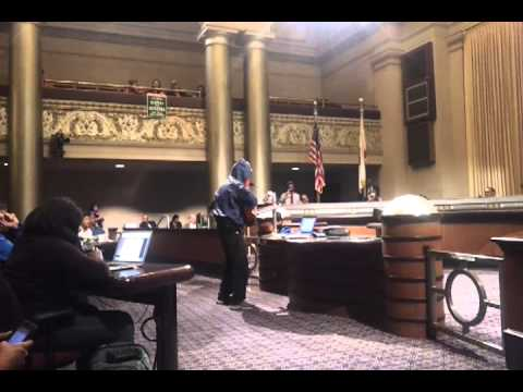 Singer at Oakland City Council meeting