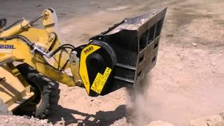 mb l crusher bucket working on a backhoe loader