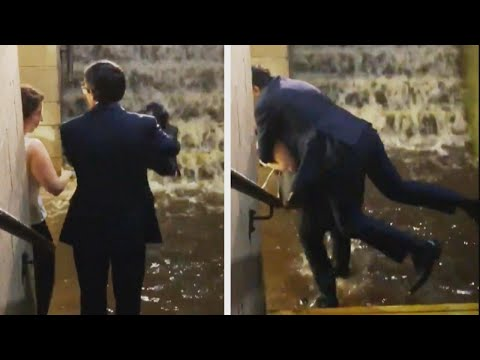 Lance Houston - Woman Gives Man in Suit Piggyback to Avoid Flooding