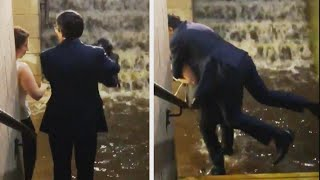 Woman Gives Man in Suit Piggyback to Avoid Flooding