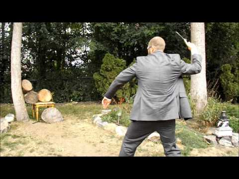 Businessman Knife Thrower | Throwing Knives in a Suit