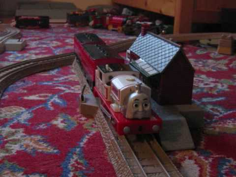 Stanley pulling coaches and freight cars trackmaster runs.wmv