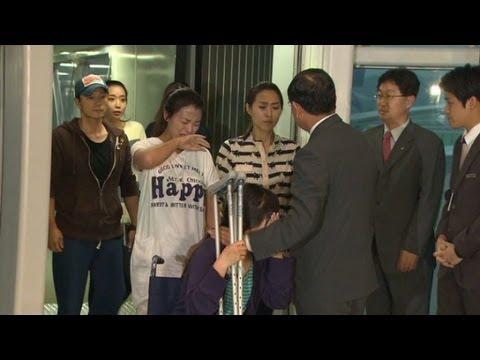 Asiana attendants return home