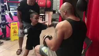 Kids boxing with Coach Nelson