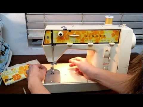 How to thread a singer Genie sewing machine