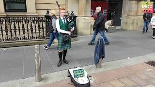 Young and talented traditional bagpiper, in Buchanan Street, Glasgow