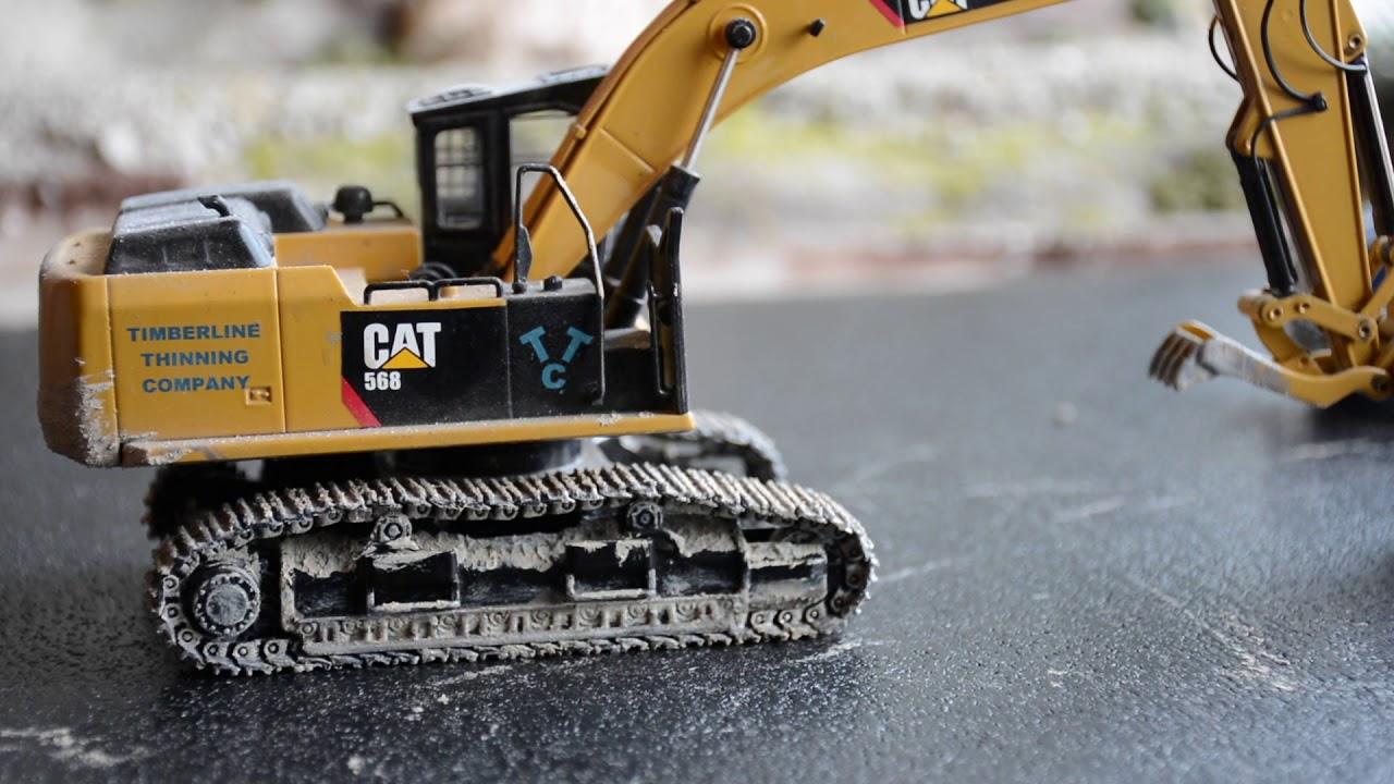 weathered 1 50 cat 568 road builder excavator youtube