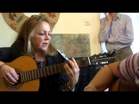 Leaving on a Jetplane, sung by Ann Lloyd and Helen Whittaker