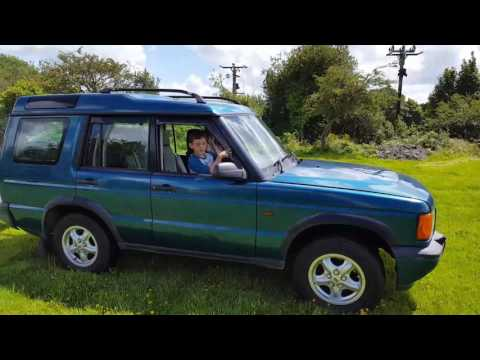 Daniel aged 7 driving discovery with Rue and Tobias in trailer