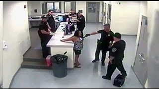 Shocking Video catches Cop Tasing Handcuffs Woman Breast