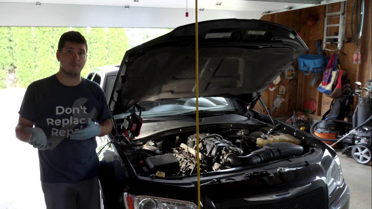 how to replace the spark plugs in a 5 7l hemi chrysler 300 tune up [ 1280 x 720 Pixel ]
